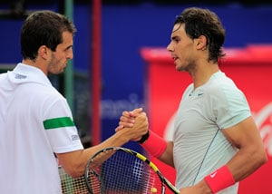Rafael Nadal does double duty to reach Barcelona Open semis