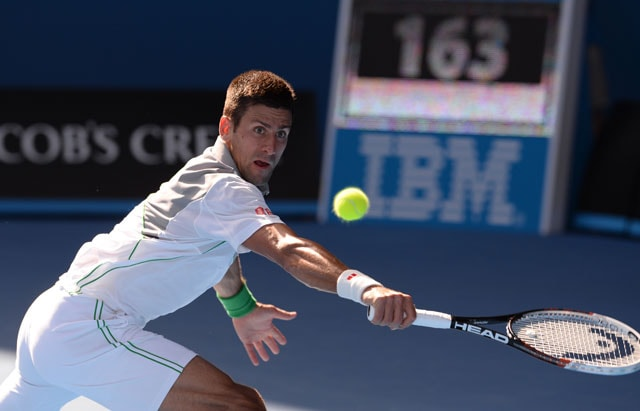 Australian Open: Novak Djokovic romps into quarter-finals