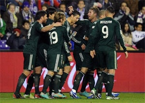 Mesut Ozil strikes twice as Real Madrid fight back for win