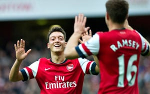 Mesut Ozil, Nicklas Bendtner keep Arsenal on top with 2-0 win over Hull City