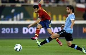 Pedro double sees Spain past Uruguay