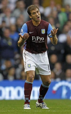 Aston Villa's Petrov retires after leukaemia diagnosis