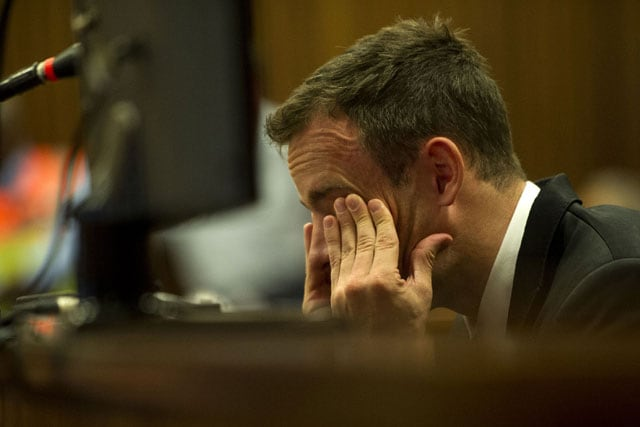 Crying Oscar Pistorius apologises to murdered girlfriend's family