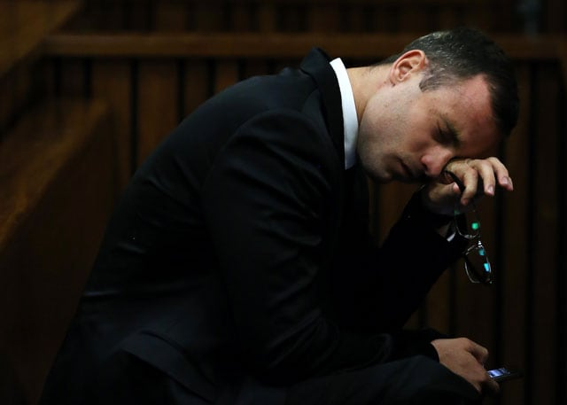 Exhausted Oscar Pistorius leaves court after giving evidence as judge grants adjournment