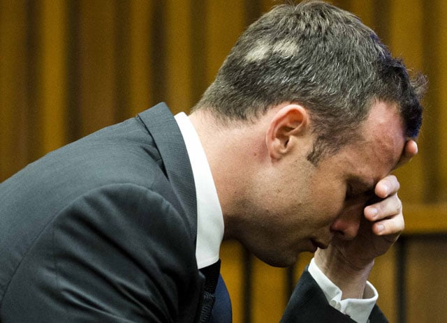 Oscar Pistorius in tears again as blood-stained images of girlfriend shown in court
