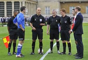 'Mind the windows!' Prince William tells palace footballers