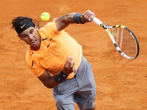 Nadal beats Nieminen to ease knee worries