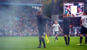 Referee hit by flare in Aston Villa-Tottenham game