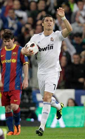 Ronaldo rescues Real Madrid but Barcelona sense title