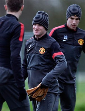 Wayne Rooney and David de Gea train ahead of