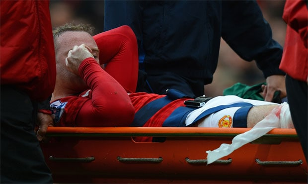 Injured Wayne Rooney faces a month out