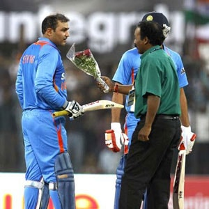 Sehwag's rare dive and a bouquet