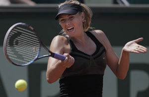Sharapova wins 6-0, 6-0 in French Open's 1st round