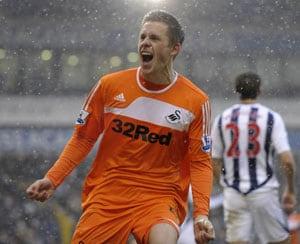 Gylfi Sigurdsson completes Tottenham move