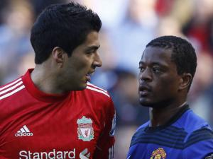 Suarez charged with racially abusing Evra