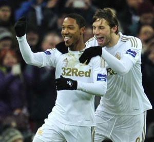 Swansea crush Bradford 5-0 to claim League Cup crown