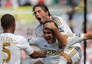 Fletcher double ends Swansea's perfect start