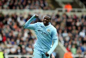 Yaya Toure puts Manchester City within sight of title