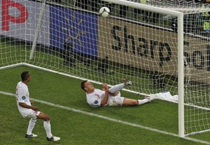 FIFA approves goal-line technology, five officials at matches