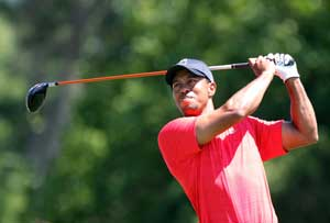 Woods quiets doubters with a flick of his wrists