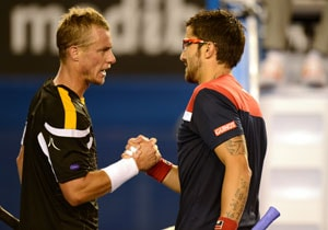 Australian Open: Janko Tipsarevic tips out tenacious Lleyton Hewitt in first round