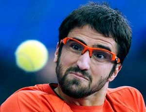 On-form Tipsarevic sets up Bellucci clash