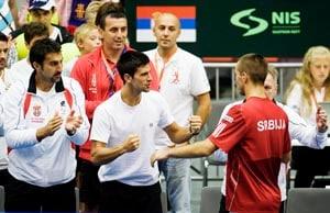 Serbia shrug off Djokovic blow, eye semi-finals