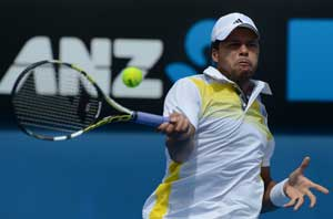 Jo-Wilfried Tsonga stops Go to reach third round