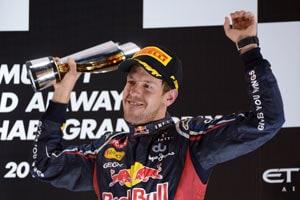 Luck? 'Superhero' Sebastian Vettel has the moves too!
