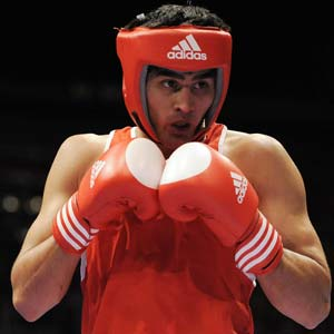 Vijender Singh punches past viral fever to dominate World Championship opener