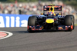 Japanese Grand Prix: Mark Webber sets pace as Michael Schumacher crashes
