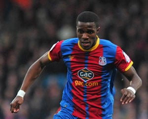 Moyes says Wilfried Zaha set for Manchester United tour; insists Rooney not for sale