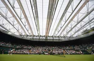 Federer fears roof makes Wimbledon a lottery