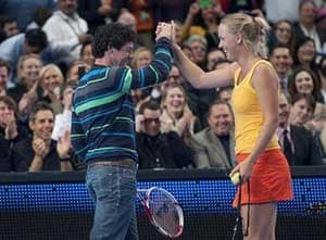 McIlroy plays tennis with Wozniacki
