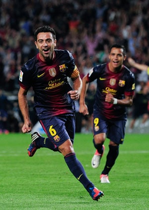 Supersub Xavi sets up late Barcelona win