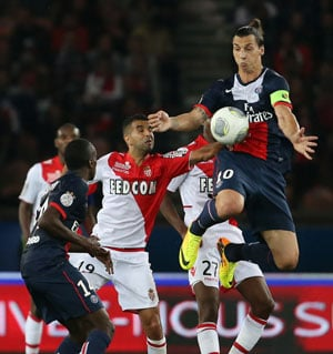 Monaco hold PSG, stay top in France