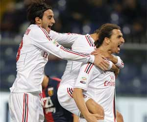 AC Milan beat 10-man Genoa 2-0 in Serie A